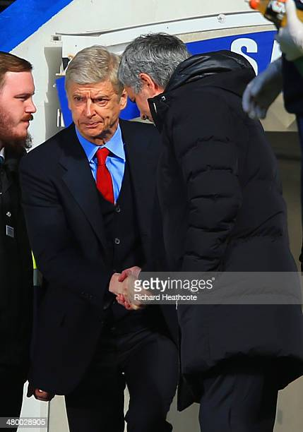 Arsene Wenger manager of Arsenal is greeted by Jose Mourinho manager of Chelsea during the Barclays Premier League match between Chelsea and Arsenal...