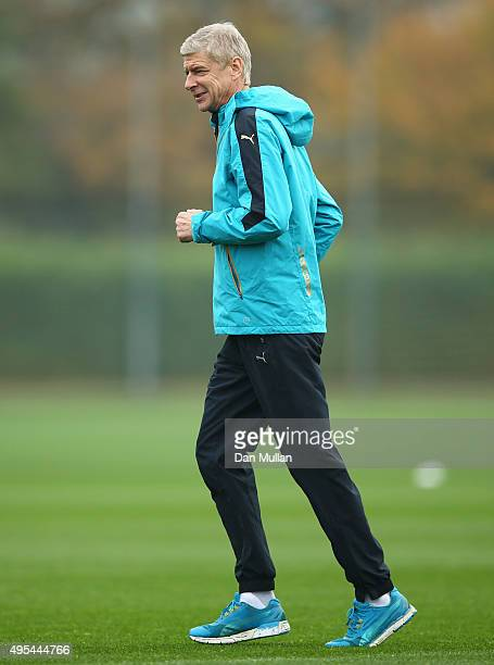 Arsene Wenger manager of Arsenal jogs during an Arsenal training session on the eve of the UEFA Champions League Group F match against Bayern Munich...