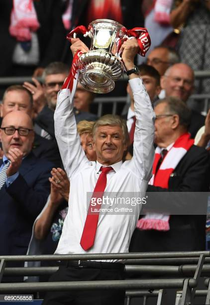 Arsene Wenger Manager of Arsenal lifts the FA Cup Trophy after The Emirates FA Cup Final between Arsenal and Chelsea at Wembley Stadium on May 27...