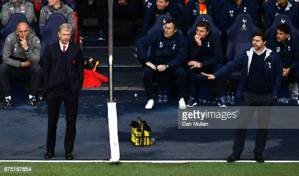 Arsene Wenger Manager of Arsenal looks on and Mauricio Pochettino Manager of Tottenham Hotspur looks on during the Premier League match between...