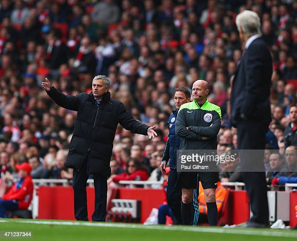 Arsene Wenger manager of Arsenal looks on as Jose Mourinho manager of Chelsea reacts during the Barclays Premier League match between Arsenal and...