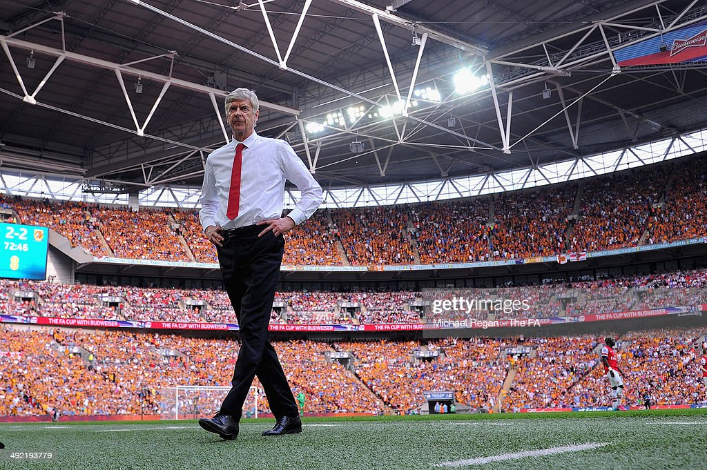 <a gi-track='captionPersonalityLinkClicked' href=/galleries/search?phrase=Arsene+Wenger&family=editorial&specificpeople=171184 ng-click='$event.stopPropagation()'>Arsene Wenger</a>, manager of Arsenal looks on during the FA Cup with Budweiser Final match between Arsenal and Hull City at Wembley Stadium on May 17, 2014 in London, England.