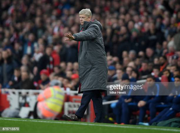 Arsene Wenger Manager of Arsenal looks on during the Premier League match between Arsenal and Tottenham Hotspur at Emirates Stadium on November 18...