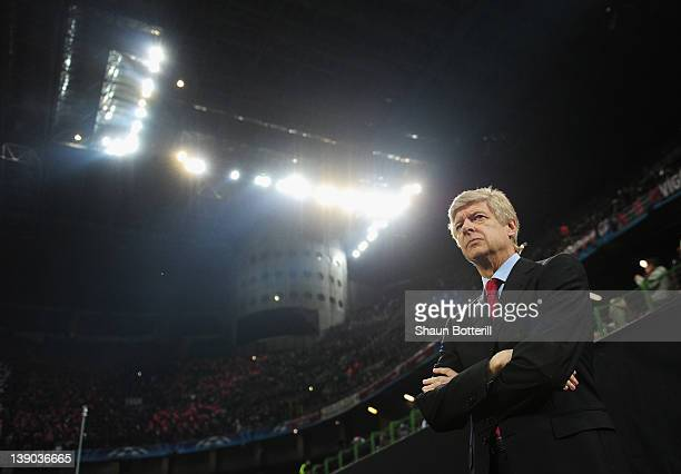 Arsene Wenger manager of Arsenal looks on during the UEFA Champions League round of 16 first leg match between AC Milan and Arsenal at Stadio...