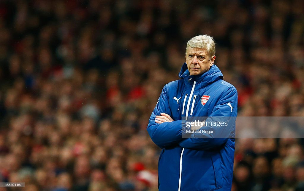 Arsene Wenger manager of Arsenal looks on during the UEFA Champions League Group D match between Arsenal FC and RSC Anderlecht at Emirates Stadium on November 4, 2014 in London, United Kingdom.