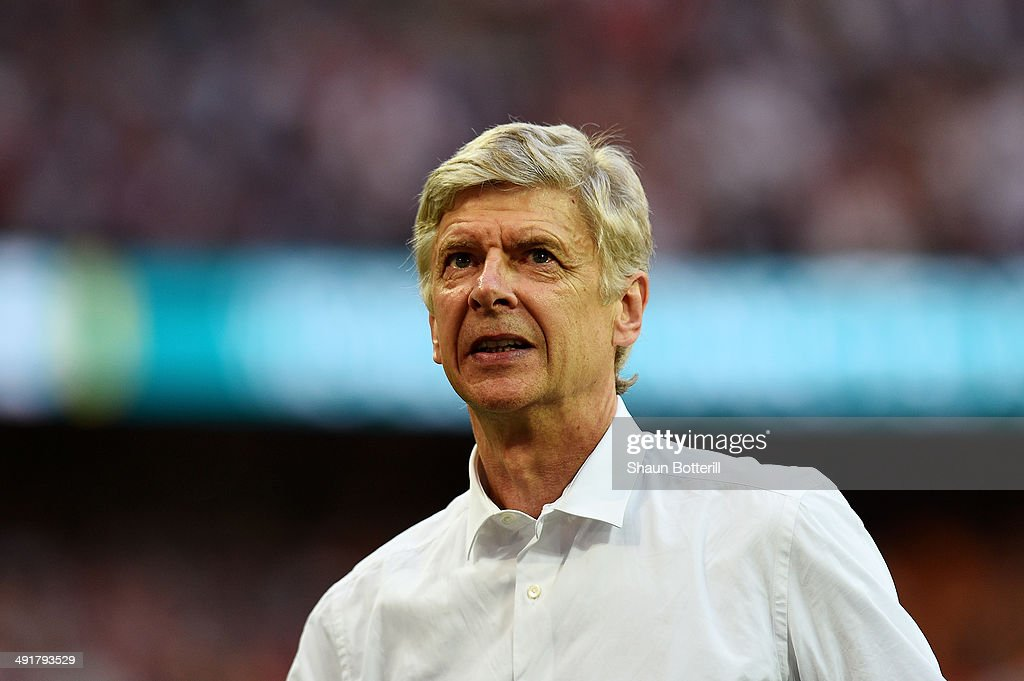 <a gi-track='captionPersonalityLinkClicked' href=/galleries/search?phrase=Arsene+Wenger&family=editorial&specificpeople=171184 ng-click='$event.stopPropagation()'>Arsene Wenger</a> manager of Arsenal looks on in victory after the FA Cup with Budweiser Final match between Arsenal and Hull City at Wembley Stadium on May 17, 2014 in London, England.