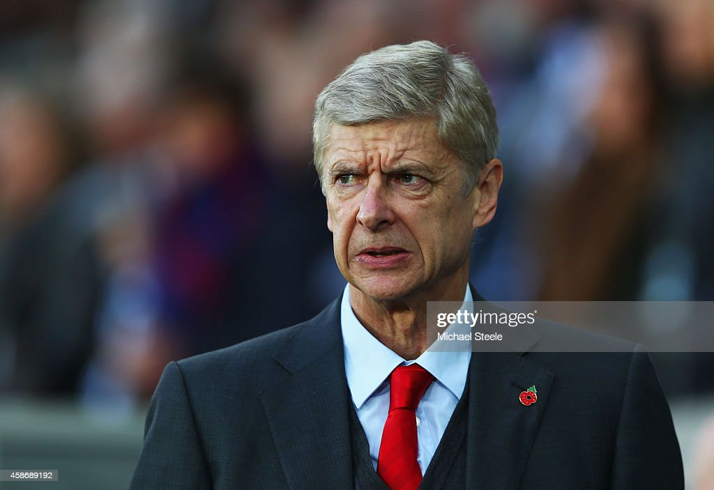 <a gi-track='captionPersonalityLinkClicked' href=/galleries/search?phrase=Arsene+Wenger&family=editorial&specificpeople=171184 ng-click='$event.stopPropagation()'>Arsene Wenger</a> manager of Arsenal looks on prior to the Barclays Premier League match between Swansea City and Arsenal at Liberty Stadium on November 9, 2014 in Swansea, Wales.