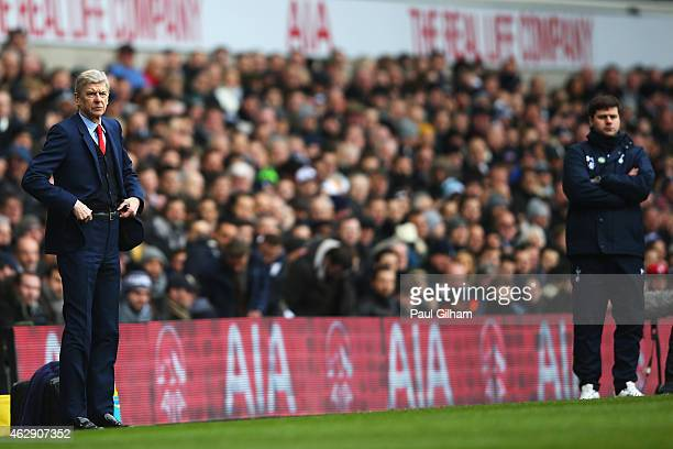 Arsene Wenger manager of Arsenal looks on with Mauricio Pochettino manager of Tottenham Hotspur during the Barclays Premier League match between...