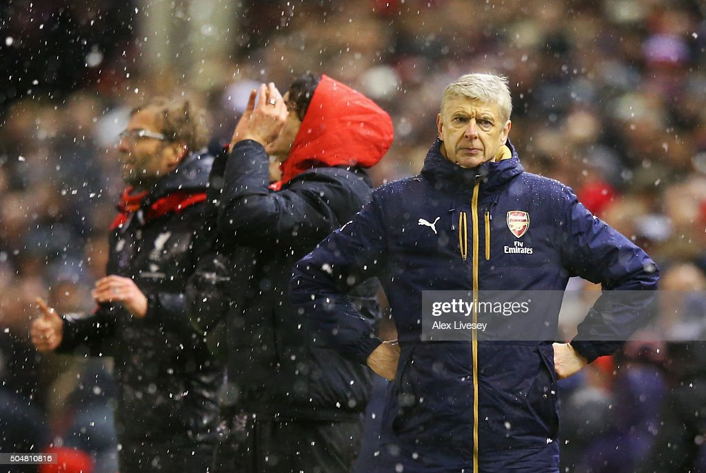 Arsene Wenger Manager of Arsenal reacts after Liverpool's third goal during the Barclays Premier League match between Liverpool and Arsenal at Anfield on January 13, 2016 in Liverpool, England.