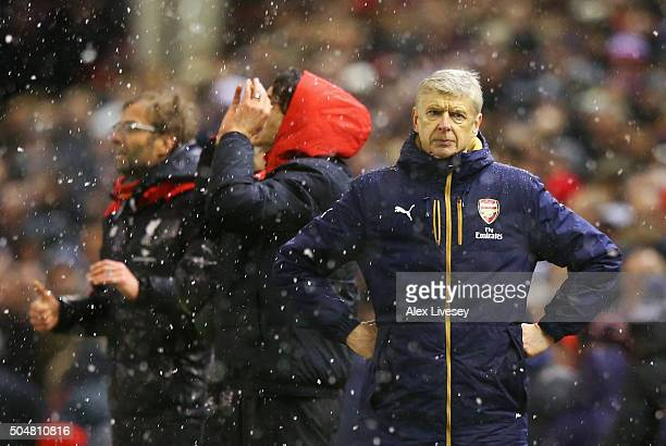 Arsene Wenger Manager of Arsenal reacts after Liverpool's third goal during the Barclays Premier League match between Liverpool and Arsenal at...