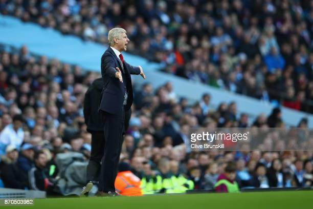 Arsene Wenger Manager of Arsenal reacts during the Premier League match between Manchester City and Arsenal at Etihad Stadium on November 5 2017 in...