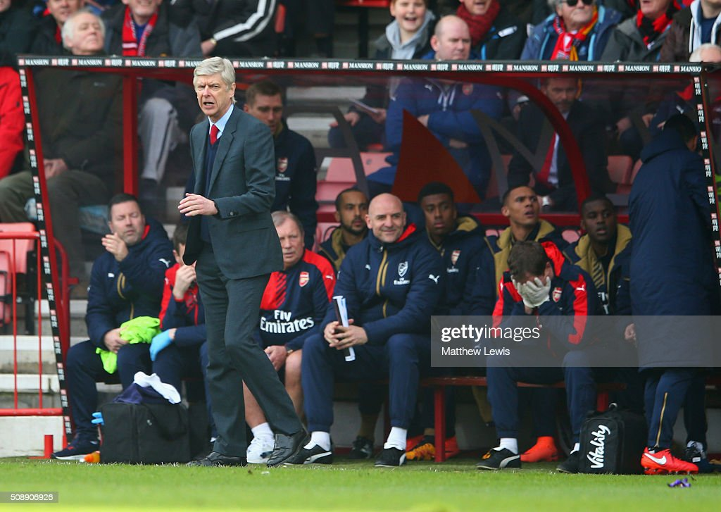 <a gi-track='captionPersonalityLinkClicked' href=/galleries/search?phrase=Arsene+Wenger&family=editorial&specificpeople=171184 ng-click='$event.stopPropagation()'>Arsene Wenger</a> manager of Arsenal reacts on the touchline during the Barclays Premier League match between A.F.C. Bournemouth and Arsenal at the Vitality Stadium on February 7, 2016 in Bournemouth, England.