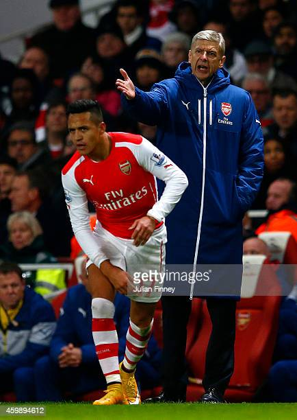 Arsene Wenger manager of Arsenal reacts to a challenge on Alexis Sanchez of Arsenal during the Barclays Premier League match between Arsenal and...