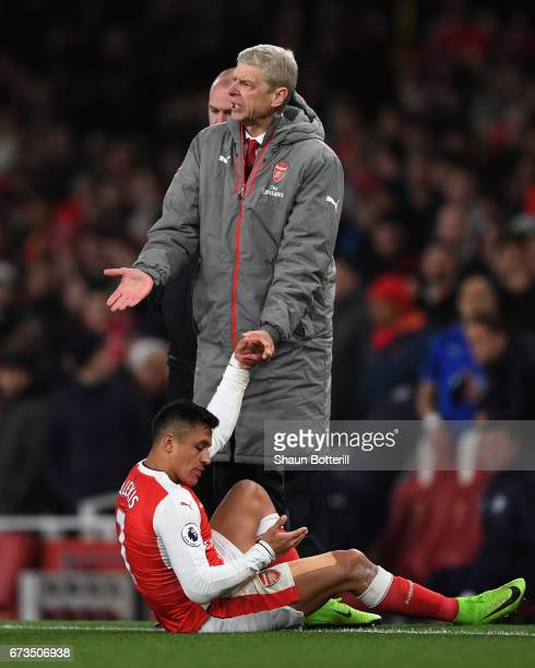 Arsene Wenger Manager of Arsenal reacts to an injured Alexis Sanchez of Arsenal during the Premier League match between Arsenal and Leicester City at...