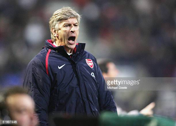 Arsene Wenger manager of Arsenal shows his frustration during the Barclays Premiership match between Bolton Wanderers and Arsenal at the Reebok...