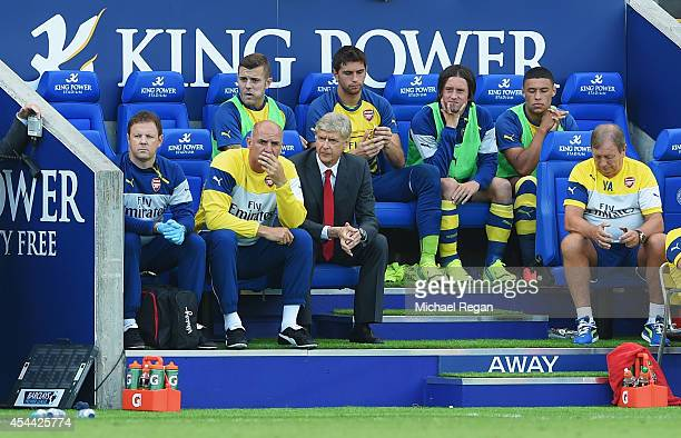 Arsene Wenger manager of Arsenal sits in the dug out with assistant Steve Bould during the Barclays Premier League match between Leicester City and...