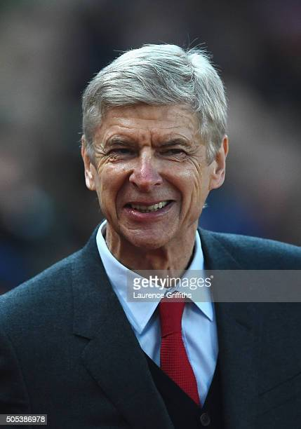 Arsene Wenger manager of Arsenal smiles prior to the Barclays Premier League match between Stoke City and Arsenal at Britannia Stadium on January 17...