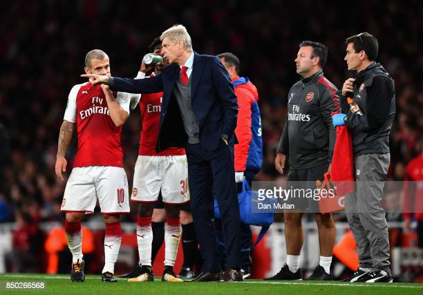Arsene Wenger Manager of Arsenal speaks to Jack Wilshere of Arsenal during the Carabao Cup Third Round match between Arsenal and Doncaster Rovers at...