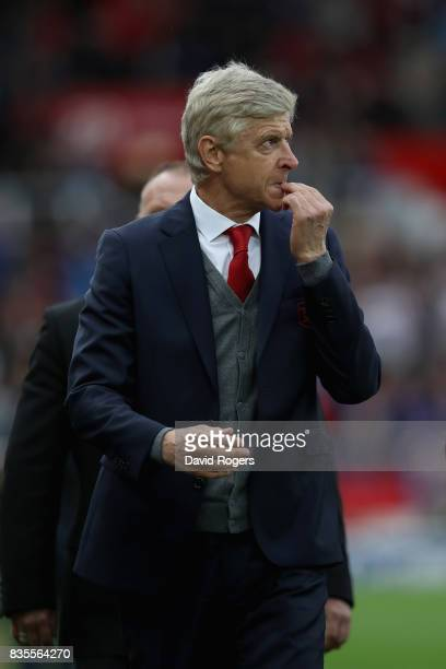 Arsene Wenger Manager of Arsenal walks off dejected after the Premier League match between Stoke City and Arsenal at Bet365 Stadium on August 19 2017...