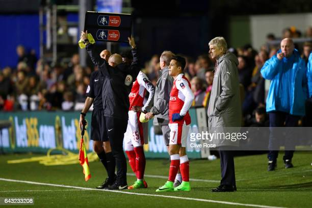 Arsene Wenger manager of Arsenal watches as Alexis Sanchez of Arsenal prepares to replace Alex Iwobi of Arsenal during the Emirates FA Cup fifth...