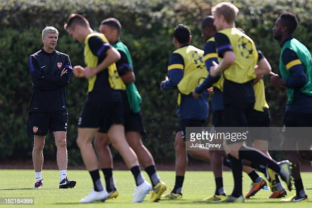 Arsene Wenger Manager of Arsenal watches his players during a training session at London Colney on September 17 2012 in St Albans England
