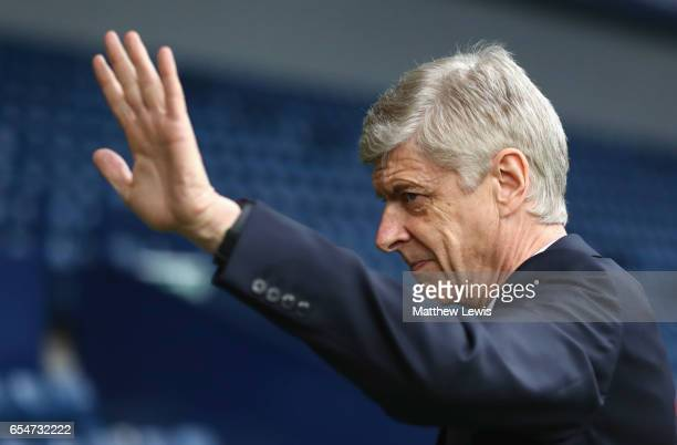 Arsene Wenger manager of Arsenal waves as he arrives prior to the Premier League match between West Bromwich Albion and Arsenal at The Hawthorns on...