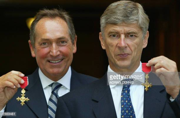 Arsene Wenger of Arsenal and Gerard Houllier of Liverpool with their OBE medals at The Foreign Office in London 09 July 2003 The honor awarded by...