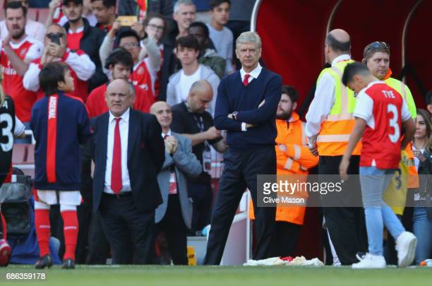 Arsene Wenger of Arsenal looks on as his players acknowledge the fans after the Premier League match between Arsenal and Everton at Emirates Stadium...
