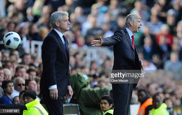 Arsene Wenger of Arsenal shows his emotions as Mark Hughes of Fulham looks on during the Barclays Premier League match between Fulham and Arsenal at...
