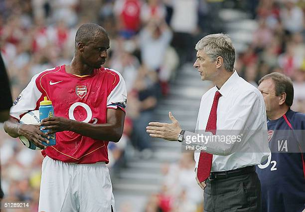 Arsene Wenger of Arsenal talks with Patrick Vieira during the Barclays Premiership match between Fulham and Arsenal at Craven Cottage on September 11...