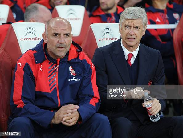 Arsene Wenger the Arsenal Manager and his Assistant Steve Bould before the Barclays Premier League match between Arsenal and Liverpool on August 24...