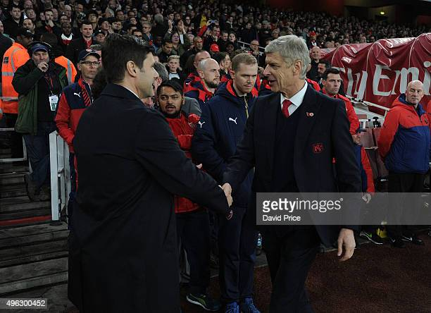 Arsene Wenger the Arsenal Manager and Mauricio Pochettino the Manager of Tottenham before the Barclays Premier League match between Arsenal and...