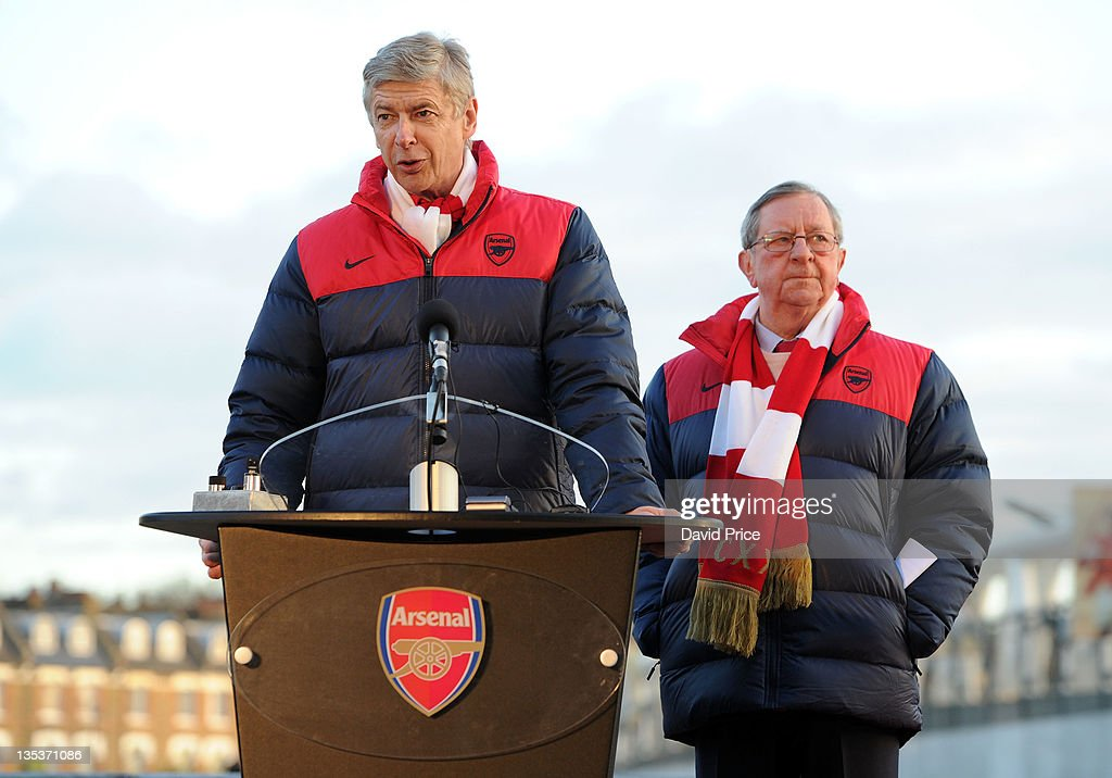 <a gi-track='captionPersonalityLinkClicked' href=/galleries/search?phrase=Arsene+Wenger&family=editorial&specificpeople=171184 ng-click='$event.stopPropagation()'>Arsene Wenger</a> the Arsenal Manager and Peter Hill-Wood the Arsenal Chairman speak at the Arsenal Legends Statue unveilling at Emirates Stadium, one of three iconic statues to be placed at the Emirates Stadium home of Arsenal Football Club, on December 9, 2011 in London, England.