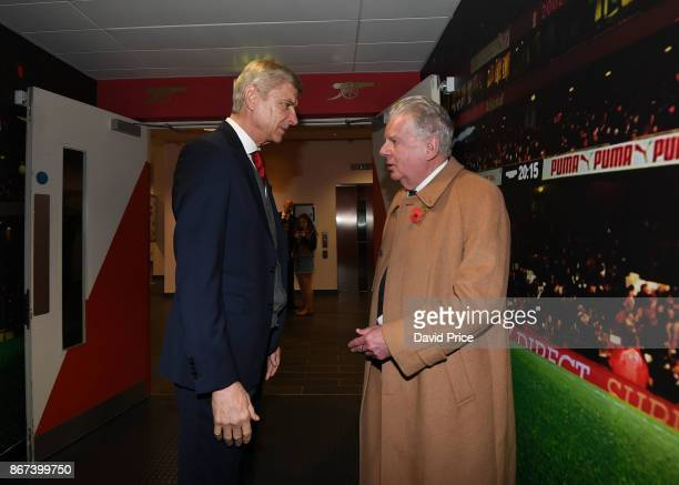 Arsene Wenger the Arsenal Manager chats with John Motson retired BBC Commentator before the Premier League match between Arsenal and Swansea City at...