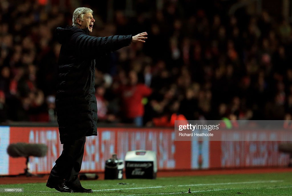 Arsene Wenger the Arsenal manager directs his players during the Barclays Premier league match between Southampton and Arsenal at St Mary's Stadium on January 1, 2013 in Southampton, England.