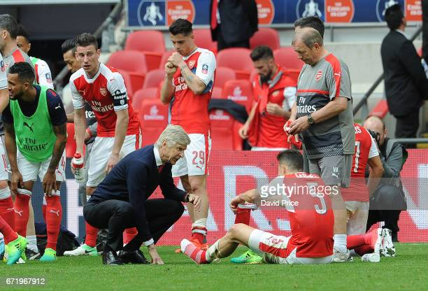 Arsene Wenger the Arsenal Manager gives some instructions to Gabriel of Arsenal at the end of normal time during the match between Arsenal and...