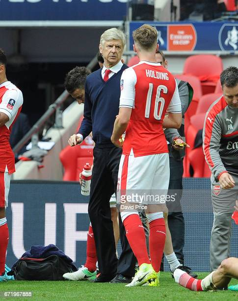 Arsene Wenger the Arsenal Manager gives some instructions to Rob Holding of Arsenal at the end of normal time during the match between Arsenal and...