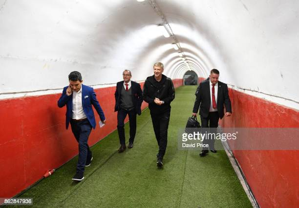 Arsene Wenger the Arsenal Manager is escorted out of the stadium after the Arsenal Press Conference ahead of the UEFA Europa League group H match...