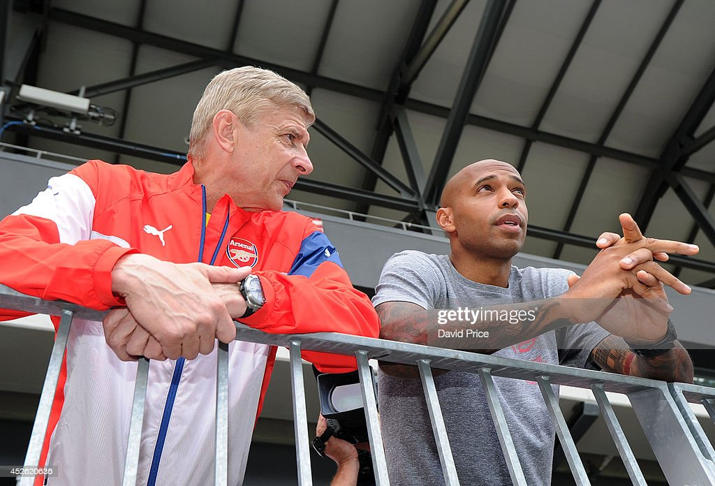 Arsene Wenger the Arsenal Manager is greeted at the stadium by Thierry henry of the New York Red Bulls before the press conference at Red Bull Arena on July 24, 2014 in Harrison, New Jersey.