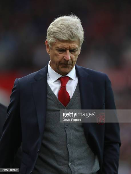 Arsene Wenger the Arsenal manager looks dejected after their defeat during the Premier League match between Stoke City and Arsenal at Bet365 Stadium...