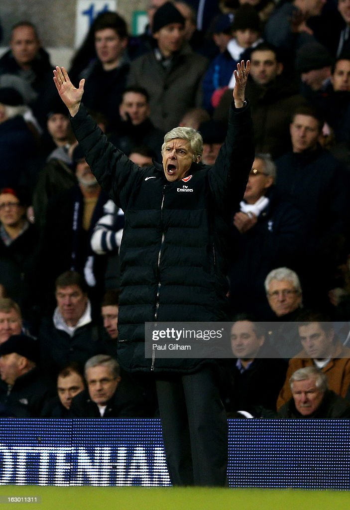 Arsene Wenger the Arsenal manager reacts during the Barclays Premier League match between Tottenham Hotspur and Arsenal FC at White Hart Lane on March 3, 2013 in London, England.