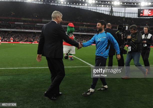 Arsene Wenger the Arsenal Manager shakes hands with Danny Cowley the Lincoln Manager before the match between Arsenal and Lincoln City at Emirates...