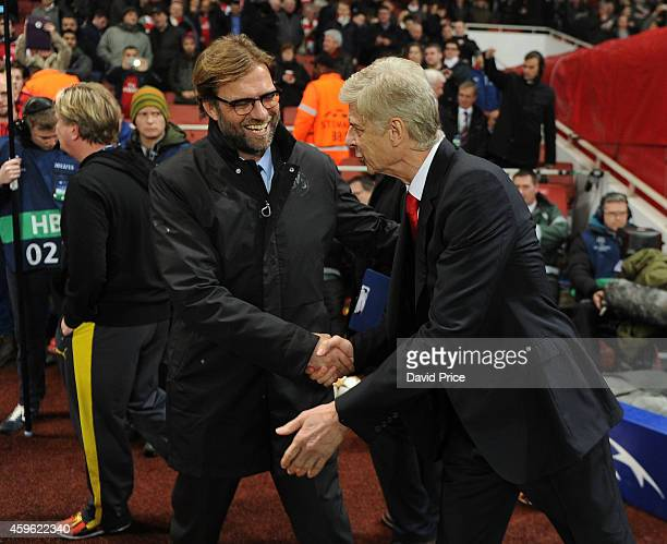 Arsene Wenger the Arsenal Manager shakes hands with Jurgen Klopp of Dortmund before the match between Arsenal and Borussia Dortmund in the UEFA...