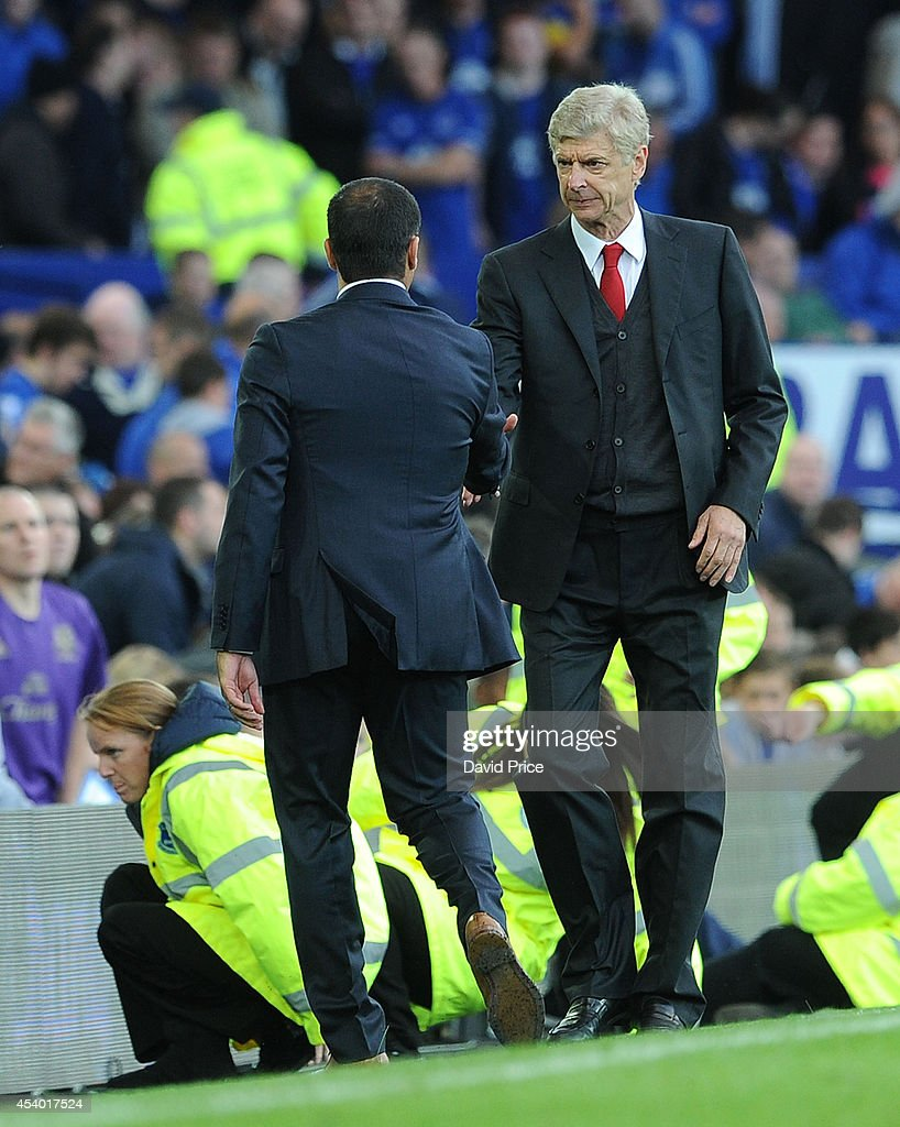 <a gi-track='captionPersonalityLinkClicked' href=/galleries/search?phrase=Arsene+Wenger&family=editorial&specificpeople=171184 ng-click='$event.stopPropagation()'>Arsene Wenger</a> the Arsenal Manager shakes hands with Roberto Martinez the Manager of Everton after the Barclays Premier League match between Everton and Arsenal at Goodison Park on August 23, 2014 in Liverpool, England.