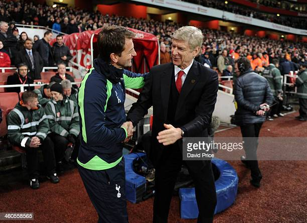 Arsene Wenger the Arsenal Manager shakes hands with Tim Sherwood the Tottenham Manager before the FA Cup 3rd Round match between Arsenal and...