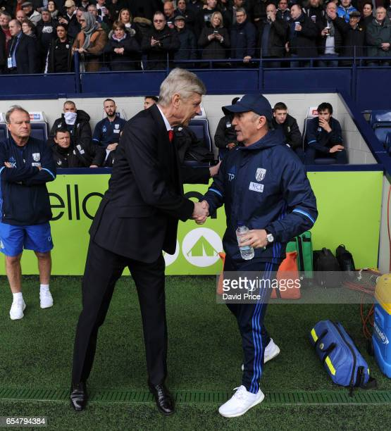 Arsene Wenger the Arsenal Manager shakes hands with Tony Pulis the WBA Manager before the Premier League match between West Bromwich Albion and...