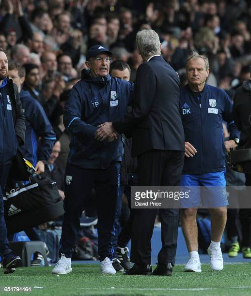 Arsene Wenger the Arsenal Manager shakes hands with Tony Pulis the WBA Manager after the Premier League match between West Bromwich Albion and...