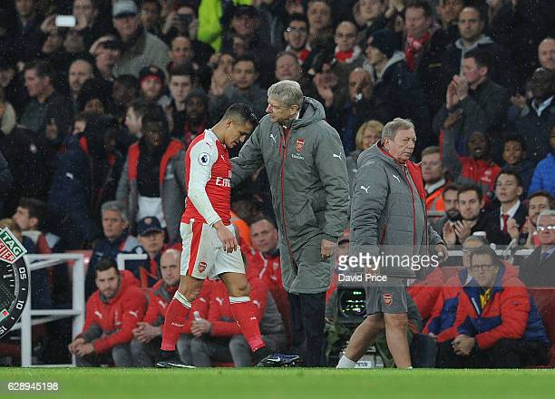 Arsene Wenger the Arsenal Manager with Alexis Sanchez of Arsenal during the Premier League match between Arsenal and Stoke City at Emirates Stadium...