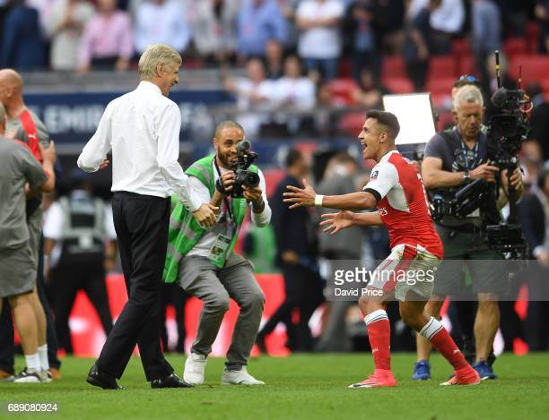 Arsene Wenger the Manager celebrates with Alexis Sanchez after the match between Arsenal and Chelsea at Wembley Stadium on May 27 2017 in London...