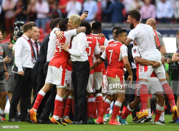 Arsene Wenger the Manager celebrates with Hector Bellerin after the match between Arsenal and Chelsea at Wembley Stadium on May 27 2017 in London...